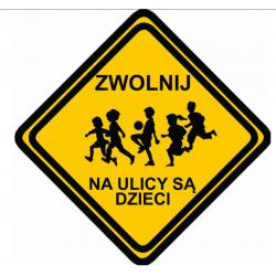 Znak ZWOLNIJ na ulicy są dzieci